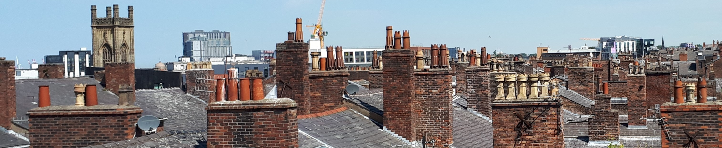 Photograph of roof tops and chimneys in Liverpool.