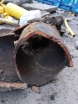 Photograph of salvaged section of original gas main
