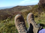 Photograph of hills with walking boots in foreground