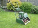Photograph of ATCO 17-inch petrol lawnmower in a garden